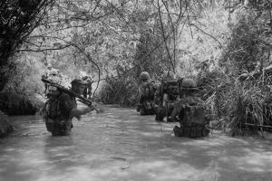 US Marines Move Through Water in Vietnam, July 1966