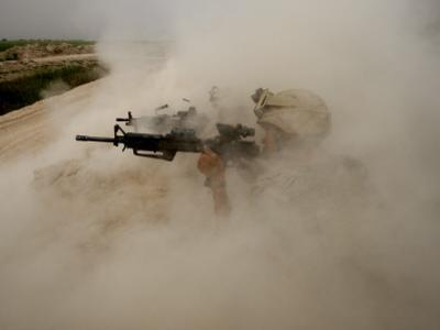 US Marines Return Fire on Taliban Positions Near the Town of Garmser in Afghanistan