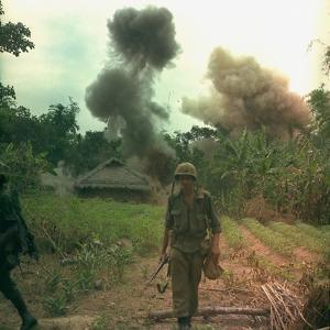 US Marines Walk Away from Blown Up Viet Cong Base, May 1966