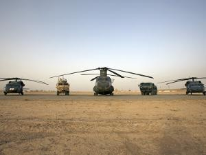 US Military Vehicles and Aircraft Lined Up on the Taxiway at Camp Speicher, Iraq