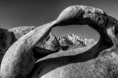 https://imgc.allpostersimages.com/img/posters/usa-california-alabama-hills-black-and-white-of-mobius-arch-at-sunrise_u-L-Q1D0BZZ0.jpg?p=0