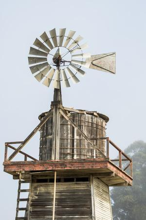 https://imgc.allpostersimages.com/img/posters/usa-california-cayucos-old-wooden-water-tower-with-windmill-for-pumping_u-L-Q1CZX6P0.jpg?artPerspective=n