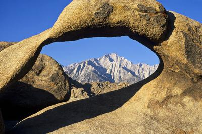 https://imgc.allpostersimages.com/img/posters/usa-california-eastern-sierra-lone-pine-peak-through-the-mobius-arch-in-the-alabama-hills_u-L-Q12T3SQ0.jpg?p=0