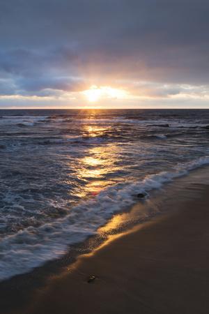https://imgc.allpostersimages.com/img/posters/usa-california-la-jolla-sunset-over-beach_u-L-Q1CZRN50.jpg?artPerspective=n