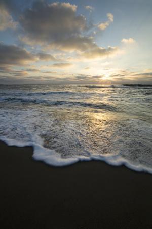 https://imgc.allpostersimages.com/img/posters/usa-california-la-jolla-sunset-over-beach_u-L-Q1D03S90.jpg?artPerspective=n