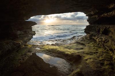 https://imgc.allpostersimages.com/img/posters/usa-california-la-jolla-sunset-though-a-sea-cave_u-L-Q1D0I7R0.jpg?p=0