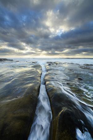 https://imgc.allpostersimages.com/img/posters/usa-california-la-jolla-wave-flows-through-cracked-sandstone_u-L-Q1D0J010.jpg?p=0