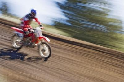 https://imgc.allpostersimages.com/img/posters/usa-california-mammoth-lakes-blur-of-motocross-racer_u-L-Q1D0B0J0.jpg?p=0