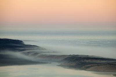 https://imgc.allpostersimages.com/img/posters/usa-california-moro-bay-morning-fog-on-sand-dunes-and-ocean_u-L-Q1D03V10.jpg?p=0