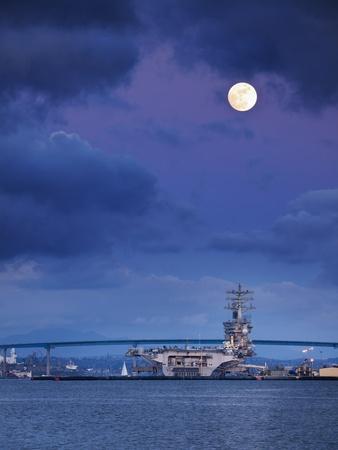 https://imgc.allpostersimages.com/img/posters/usa-california-san-diego-uss-nimitz-moored-under-full-moon-in-san-diego-bay_u-L-Q12T37D0.jpg?p=0