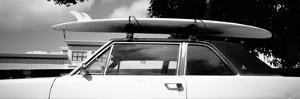 Usa, California, Surf Board on Roof of Car