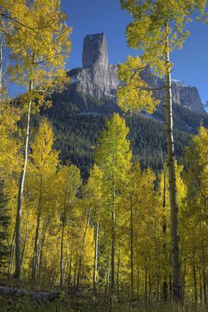 https://imgc.allpostersimages.com/img/posters/usa-colorado-san-juan-mountains-autumn-aspen-trees-frame-chimney-rock_u-L-Q1D0S3Z0.jpg?p=0