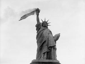 Usa, New York State, New York City, Statue of Liberty with Flag
