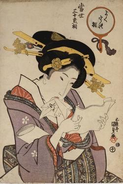 Portrait of a Courtesan Reading a Love Letter by Utagawa Kunisada