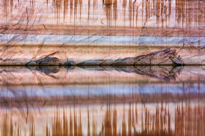 https://imgc.allpostersimages.com/img/posters/utah-glen-canyon-nra-abstract-reflection-of-stained-sandstone-wall_u-L-PU3NO00.jpg?p=0