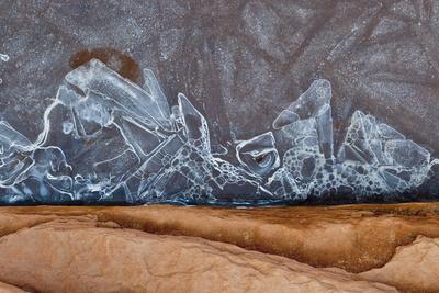 https://imgc.allpostersimages.com/img/posters/utah-natural-bridges-national-monument-frozen-sand-sandstone-and-ice-patterns_u-L-Q13AY7Z0.jpg?p=0