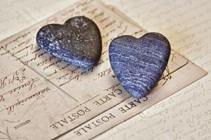 Heart Made of Stones with Old Postcard by Uwe Merkel