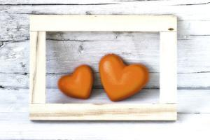 Two Hearts Made of Stone in Picture Frame by Uwe Merkel