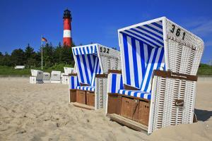 Sylt, Beach Chairs with Lighthouse on the East Beach of Hšrnum by Uwe Steffens