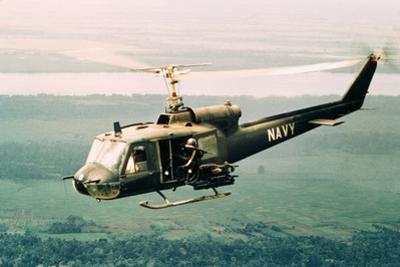 American Gunners Firing from Helicopter in Vietnam by V. McColley