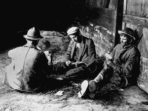 Vagrants Playing Cards in Railroad Car
