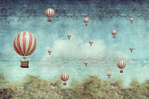 Many Hot Air Balloons Flying over a Forest by Valentina Photos