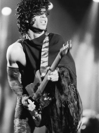 Prince, Engages the Guitar During Concert, 1984 by Vandell Cobb