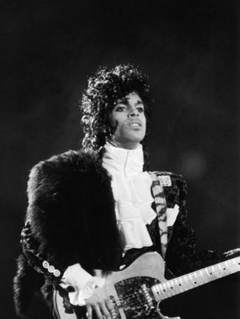 Prince Plays Guitar During Concert, 1984 by Vandell Cobb