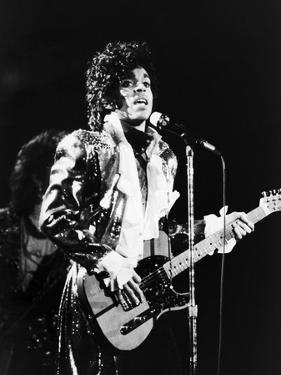 Prince, Rocks the Stage During His Purple Rain Tour in 1984 by Vandell Cobb