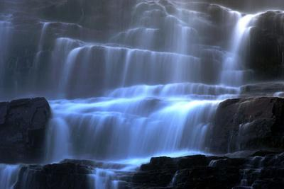 https://imgc.allpostersimages.com/img/posters/veil-fall-water-cascading-down-tvindefossen-waterfall_u-L-Q106LDM0.jpg?artPerspective=n