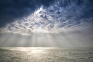 Beautiful Inspirational Sun Beams over Ocean on Cloudy Day by Veneratio