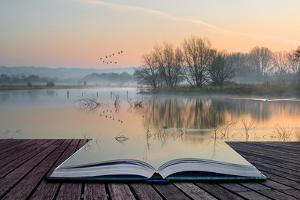 Book Concept Landscape of Lake in Mist with Sun Glow at Sunrise by Veneratio
