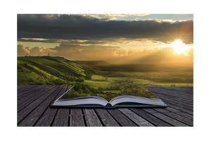 Magical Book With Contents Spilling Into Landscape Background by Veneratio