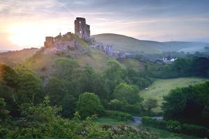 Romantic Fantasy Magical Castle Ruins against Stunning Vibrant Sunrise by Veneratio