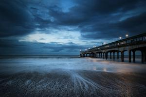Twilight Dusk Landscape of Pier Stretching out into Sea with Moonlight by Veneratio