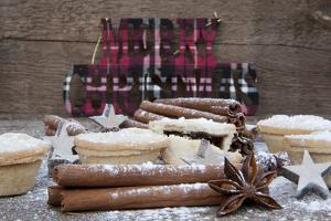 Warm Image of Christmas Foods on Rustic Style Wooden Background by Veneratio