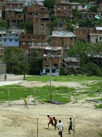 Venezuelan Children Play Soccer at the Resplandor Shantytown