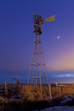 Venus and Jupiter are Visible Behind an Old Farm Water Pump Windmill, Alberta, Canada