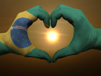 Heart And Love Gesture By Hands Colored In Brazil Flag During Beautiful Sunrise by vepar5