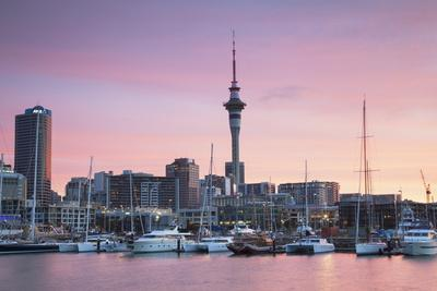 https://imgc.allpostersimages.com/img/posters/viaduct-harbour-and-sky-tower-at-sunset-auckland-north-island-new-zealand-pacific_u-L-PQ8PUB0.jpg?p=0
