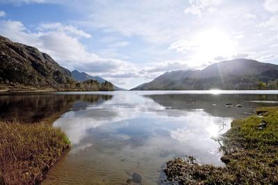 Sun Reflection of Loch Shiel Lake at Glenn Finnan Highlands Scotland