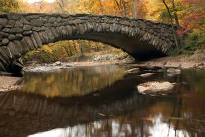 The 100 Year Old Boulder Bridge under Fall Color in Rock Creek Park by Vickie Lewis