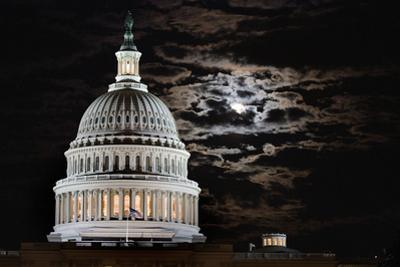 The Full Moon Rises Behind the United States Capitol Building by Vickie Lewis