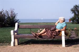 Pensioner Relaxing on a Bench by Victor De Schwanberg