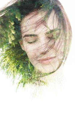 Creative Double Exposure Portrait of Woman Combined with Photograph of Nature by Victor Tongdee