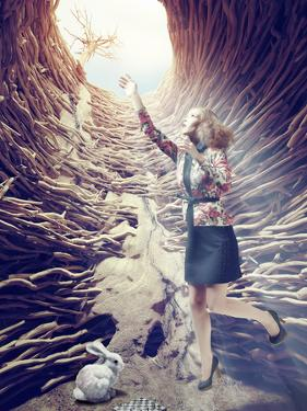 Girl Flies out of a Deep Hole toward the Sunlight. Creative Concept by viczast