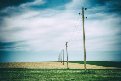 https://imgc.allpostersimages.com/img/posters/vielbrunn-hesse-germany-old-power-supply-lines-above-fields_u-L-Q11YIQY0.jpg?p=0