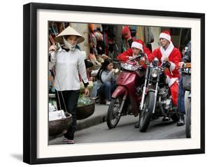 Vietnamese Men Dressed as Santa Claus Wait on their Motorbikes on a Street in Hanoi, Vietnam