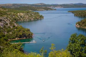 View down from Sibenik or Krka Bridge to Krka River. Sibenik-Knin County, Croatia.