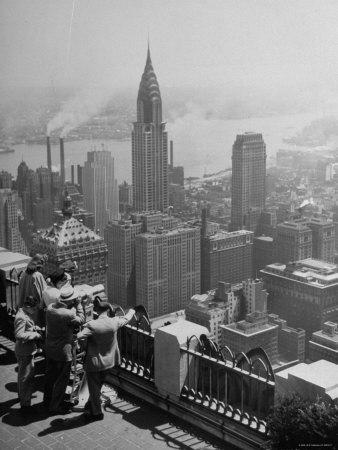 https://imgc.allpostersimages.com/img/posters/view-from-observation-deck-at-rockefeller-center-looking-southeast-at-the-chrysler-building_u-L-P3OLN50.jpg?artPerspective=n